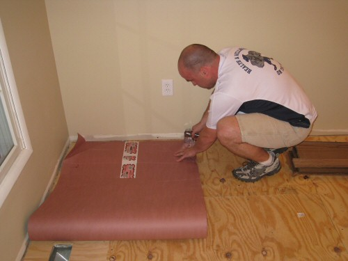 lay-red-rosin-paper-before-hardwood-installation