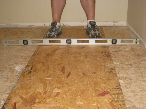 Level an uneven crowning subfloor by planing sanding for Hardwood floors uneven
