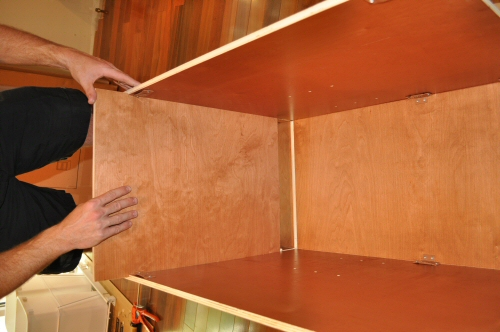 assemble the bottom of a solid wood cabinet from In Stock Kitchens
