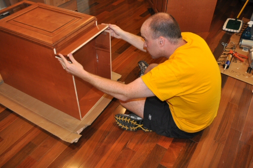 install toe kick on solid wood maple cabinets